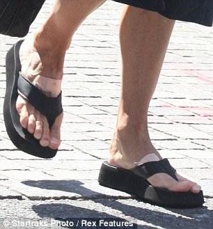 Meg Ryan's feet give a whole new meaning to down-at-heel, don't they?
