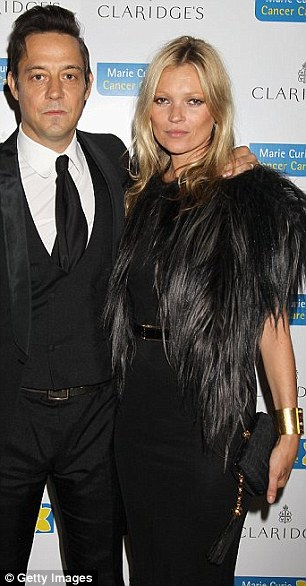 Top model Kate Moss at the 2012 Marie Curie fundraiser (with husband Jamie Hince) dressed to kill - at least her raw, red feet might feel that way