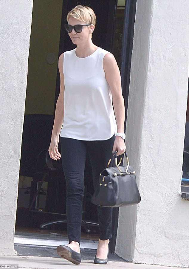 Perfect example: Charlize Theron showed off how casual chic is done while running errands around West Hollywood, California, on Friday