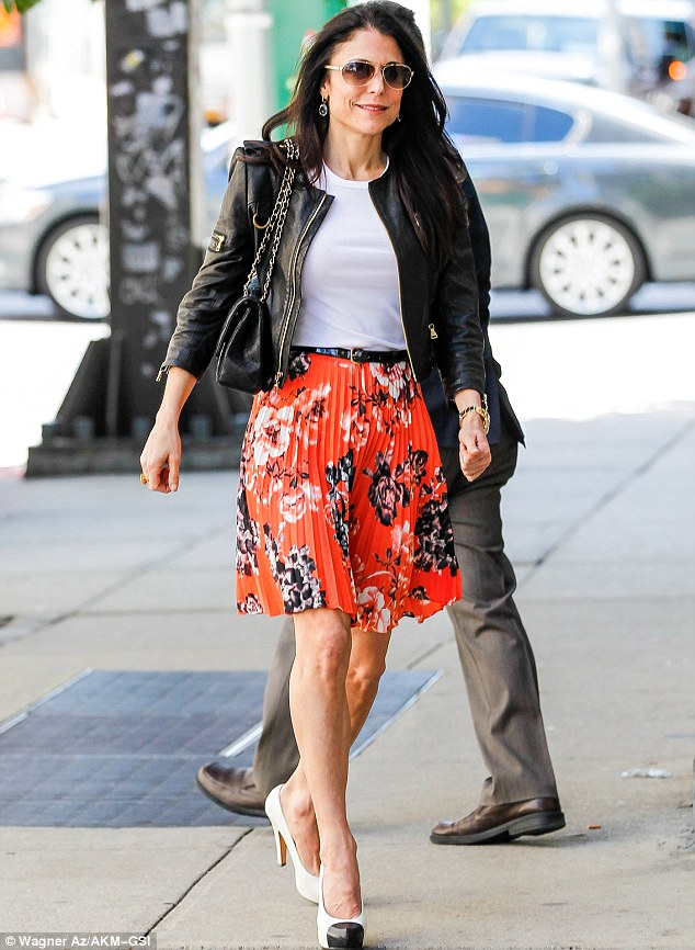 Quite the hike: The 42-year-old rocked a floral print mini skirt and leather jacket for a friendly lunch date before picking up her daughter from school