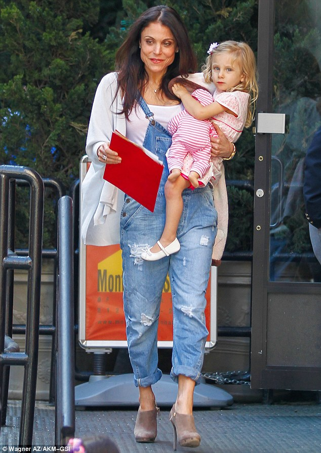 Doting mother: The Real Housewives of New York City star hip carried Bryn as they descended a set of stairs