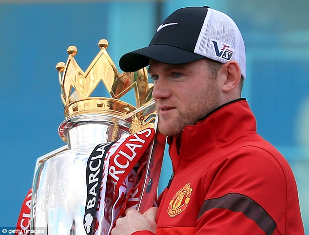 Champion: Wayne Rooney won his fifth title with Manchester United - but will he stay to win another?