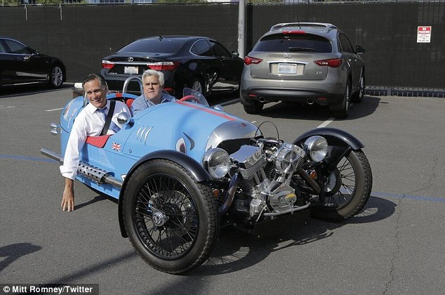 Hot ride: Leno (right) took his guest for a ride in a classic roadster