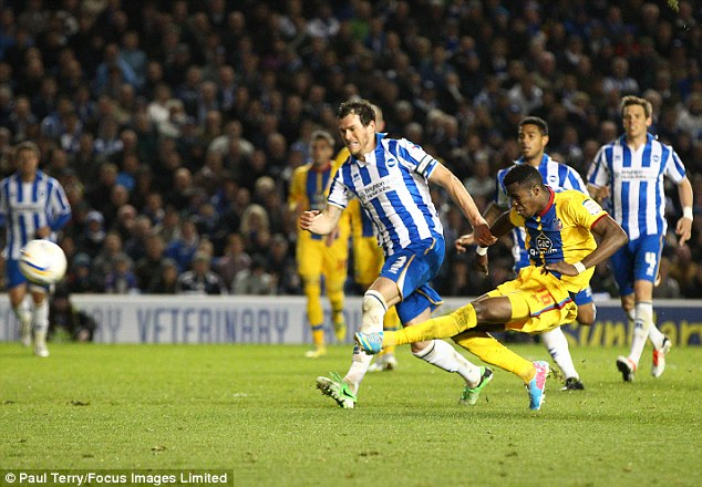 Devastating: Zaha strikes to make it 2-0 at knock Brighton out of the play-offs
