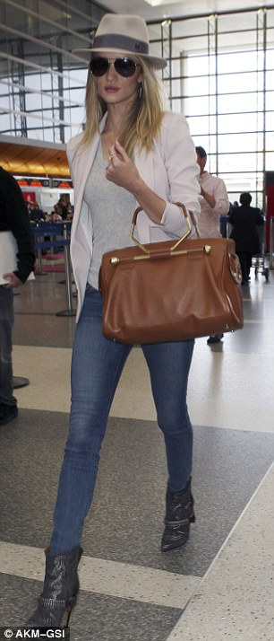 Leggy: The English model accentuated her sculpted stems in a pair of fitted denim trousers
