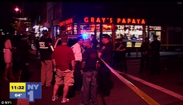Investigation: Cops on the scene after the shooting at W. 8th St. and Sixth Avenue in Greenwich Village.