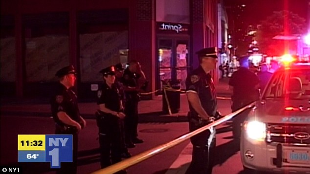 In custody: A man was taken into custody within minutes of the shooting West 8th Street and Sixth Avenue
