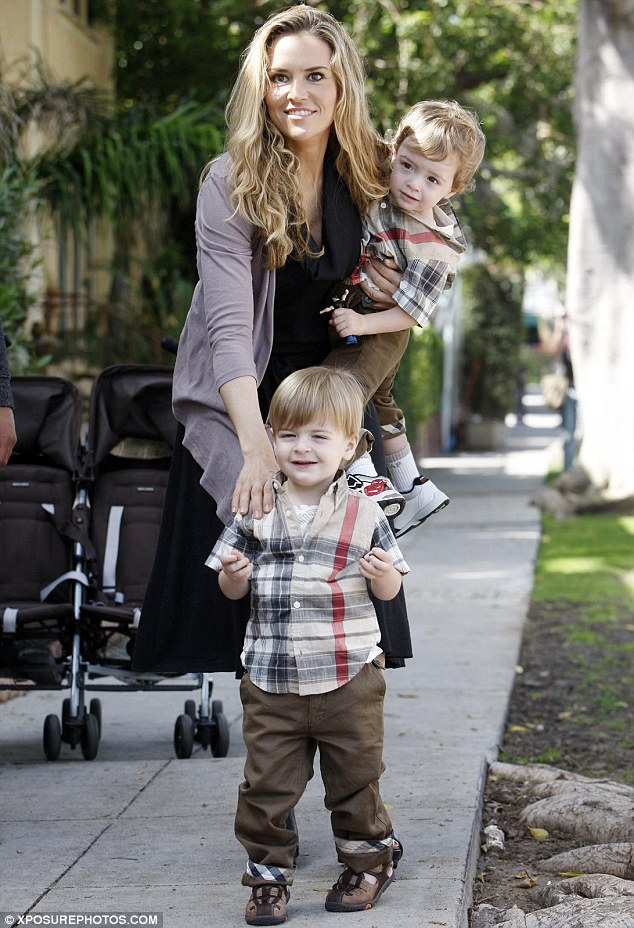 Happy mom: Brooke Mueller will reportedly be allowed to see her twin boys Bob and Max Sheen for a few hours on Sunday under the supervision of a court-appointed monitor