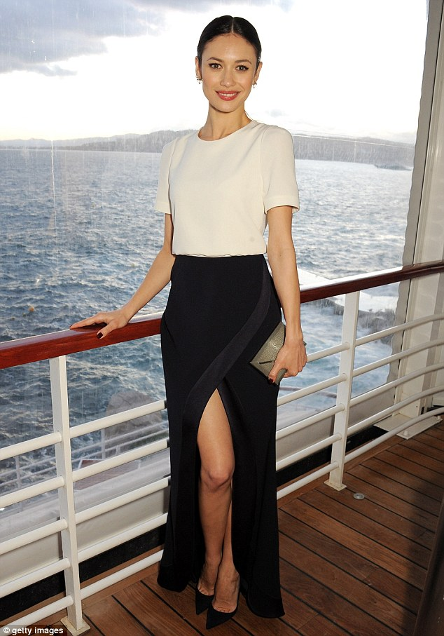 Dressed up: Olga Kurylenko dazzled in a full length black skirt and structured shouldered white silk top