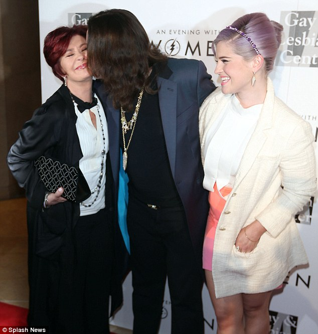 Cheeky: Ozzy planted a kiss on his wife, who is also his manager