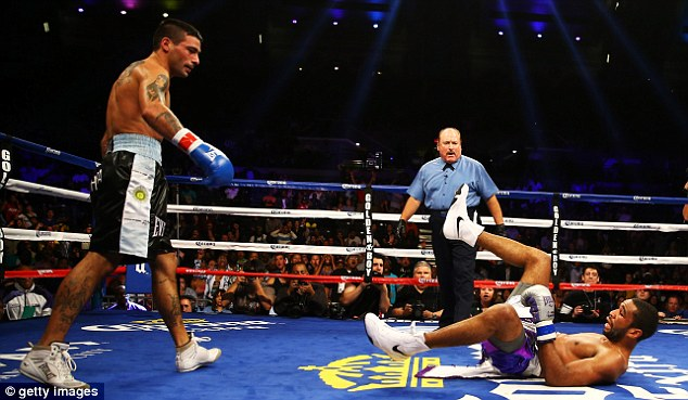 Down and out: Lucas Matthysse put Lamont Peterson on the canvas three times en-route to victory