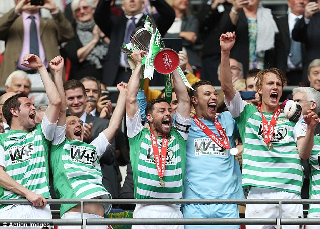 Against all odds: Yeovil captain Jamie McAllister lifts the League One play-off trophy
