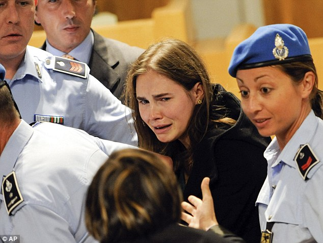 Freedom: Amanda Knox cries in court in 2011 following the verdict that overturns her conviction and acquits her of murdering her British room-mate Meredith Kercher