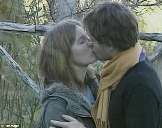 Revealing: Knox and her former boyfriend  Raffaele Sollecito (pictured shortly after Meredith Kercher's murder) have both written books about their time in jail