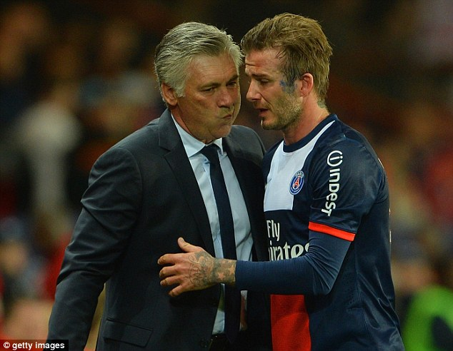 Final flourish: Ancelotti embraces the retiring David Beckham in what could be one of his last acts as PSG boss