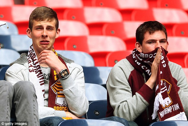 Game over: Northampton fans look dejected after their defeat to Bradford at Wembley