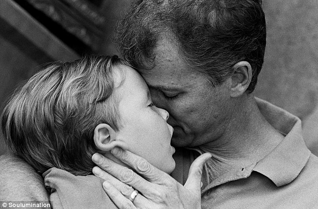A father's love: Greg, right, holds his son Blake, who died in 2006 at just five years old