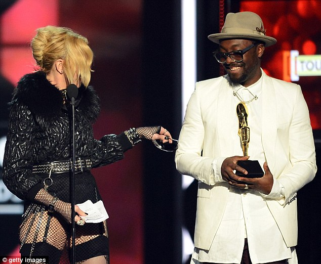 No thanks: While onstage, Madonna offered the Black Eyed Peas frontman part of her costume