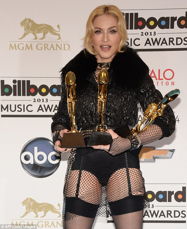 Proud: Madonna proudly posed with all of her awards after the show