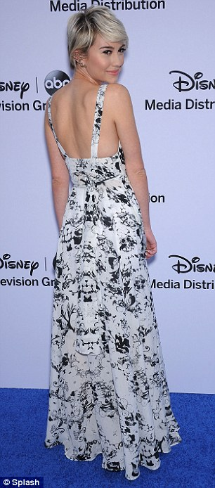 High notes: Actress and singer Chelsea Kane embraced the warm weather by wearing a back and white maxi-dress