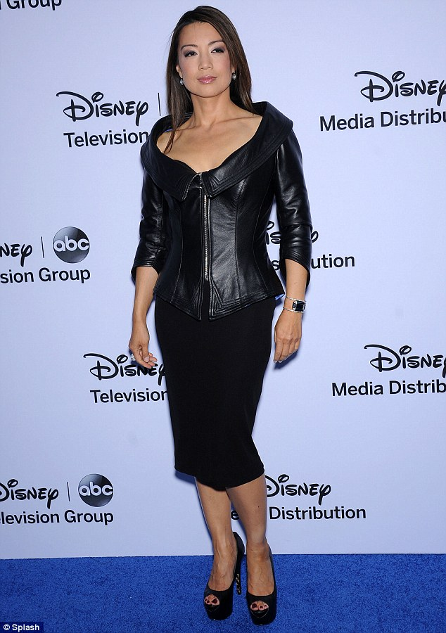 Strike a pose: Actress Ming-Na Wen looked sultry in her low cut leather coat which she teamed with a pencil skirt
