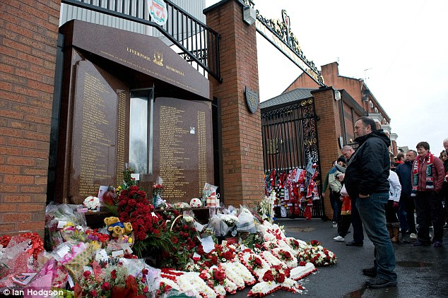 Tribute: Flowers are laid outside the Hillsborough memorial at Anfield in April for the disaster's anniversary