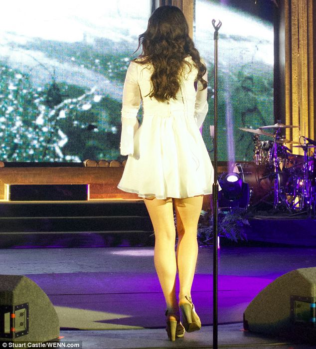 Don't bend over! It's lucky the singer didn't try to dance too much because her dress was so short