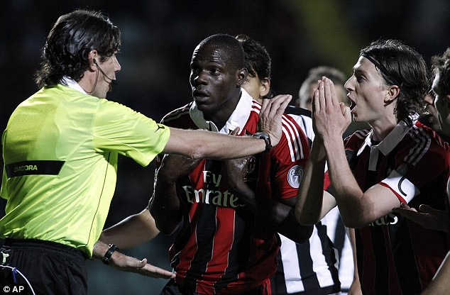 Confrontation: Balotelli and Milan team-mate Riccardo Montolivo argue with the referee