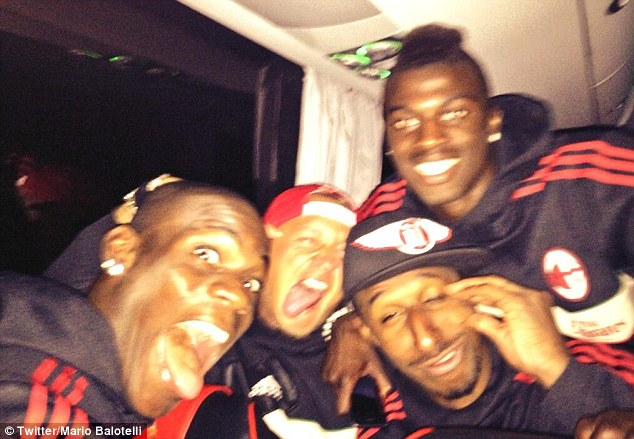 All smiles: Balotelli celebrated with team-mates after securing Champions League football