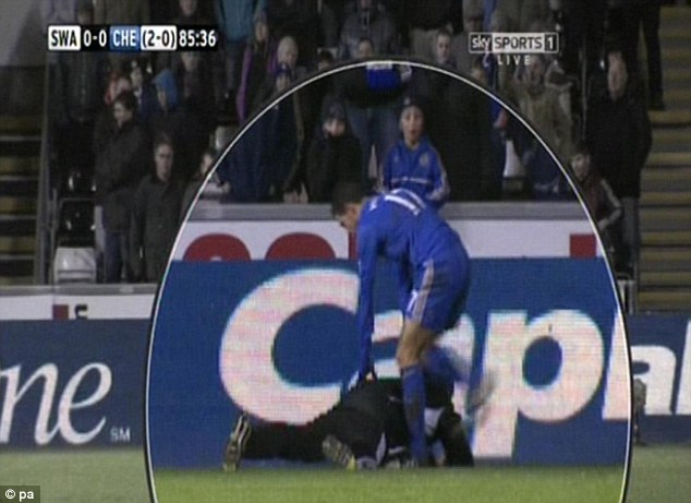 Controversy: Eden Hazard sparked debate when he tried to kick the ball from under a Swansea ballboy (below)