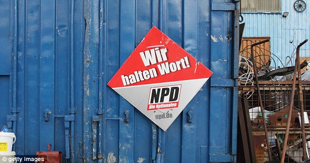 Extremist: A sign of the far-Right NPD reading 'We keep our word' is fixed to the side of a container