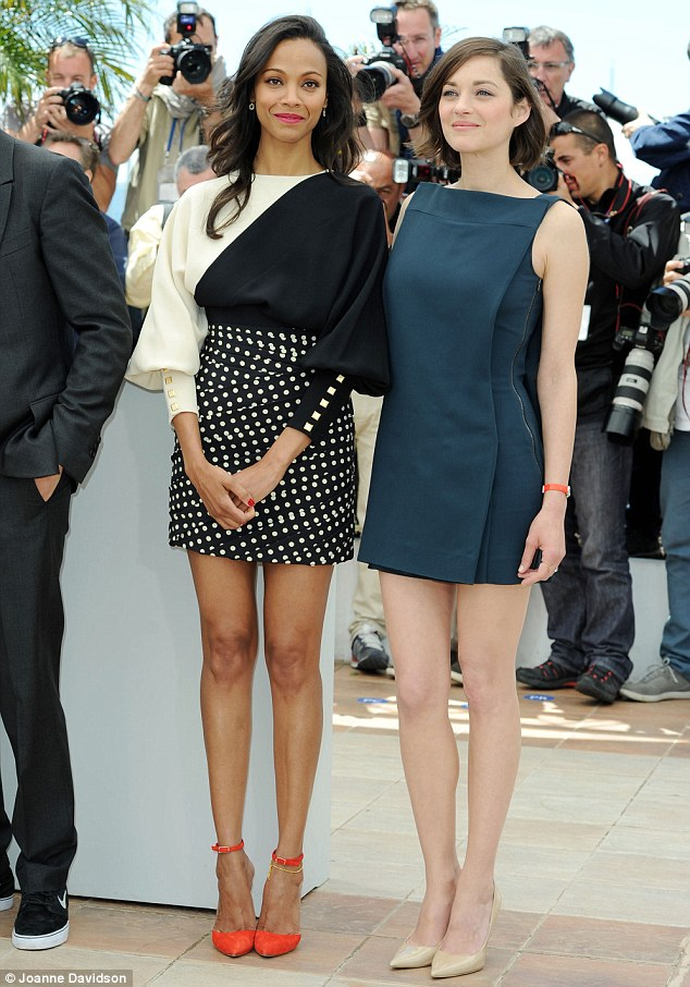 Tres chic: Marion Cotillard and Zoe Saldana put their pins on parade in stylish matching minis as they attended a photocall for their new movie Blood Ties at the 66th Cannes Film Festival on Monday