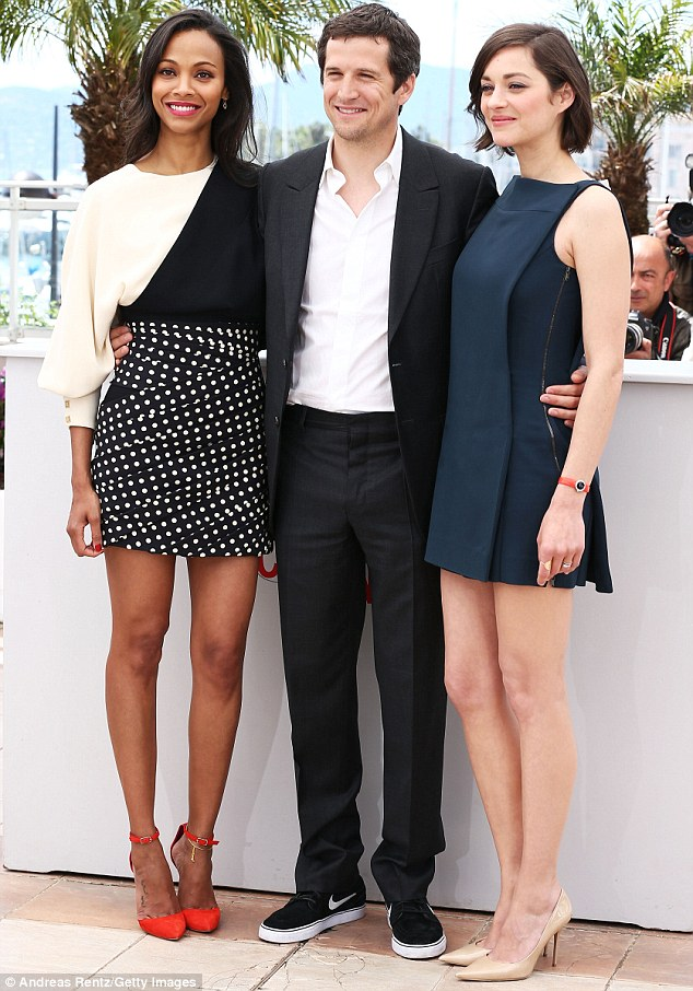Three's never a crowd: The stylish duo were joined by Marion's husband, French director Guillaume Canet