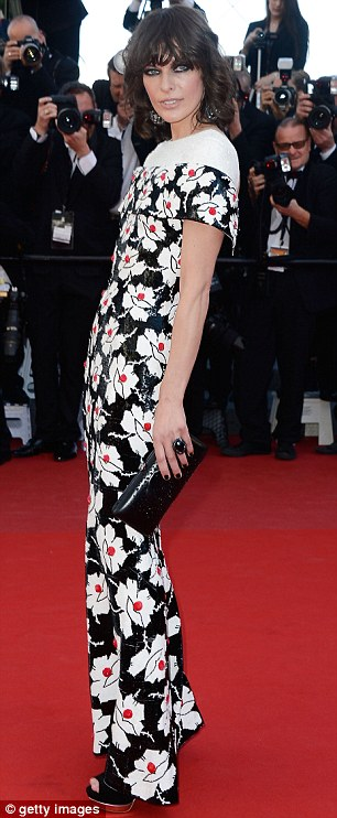 Floral: Mila opted for a long skin-tight dress on the red carpet