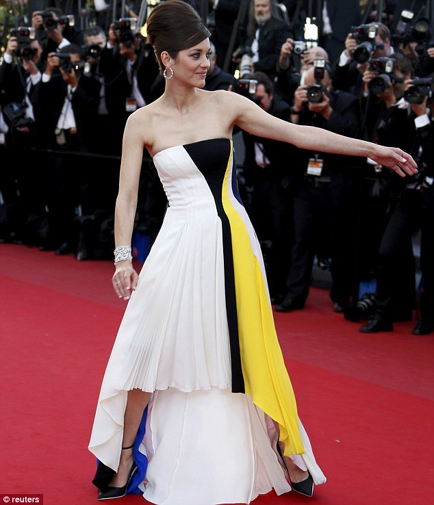Flowing: Marion reaches for a hand on the red carpet
