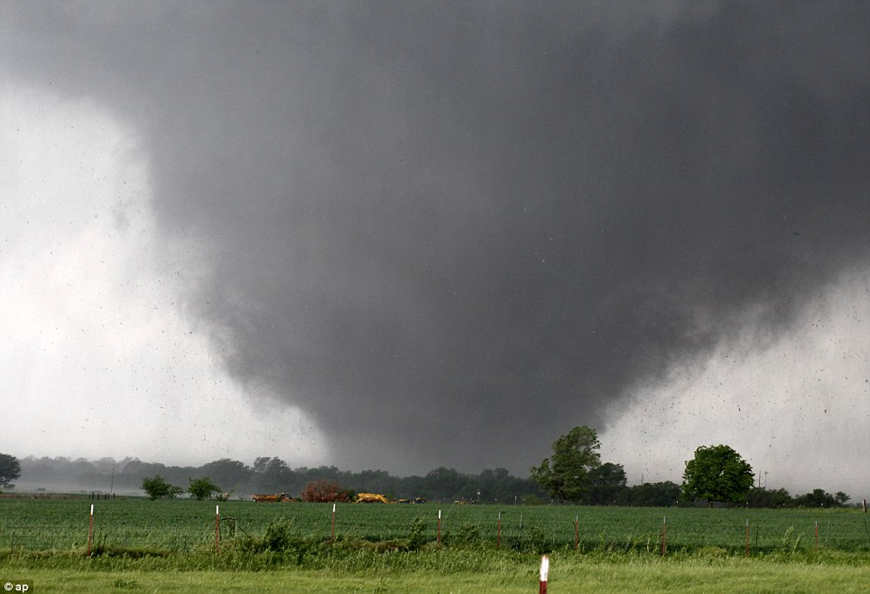 A monstrous tornado roared through the Oklahoma City suburbs, flattening entire neighborhoods with winds up to 200 mph, setting buildings on fire and landing a direct blow on an elementary school