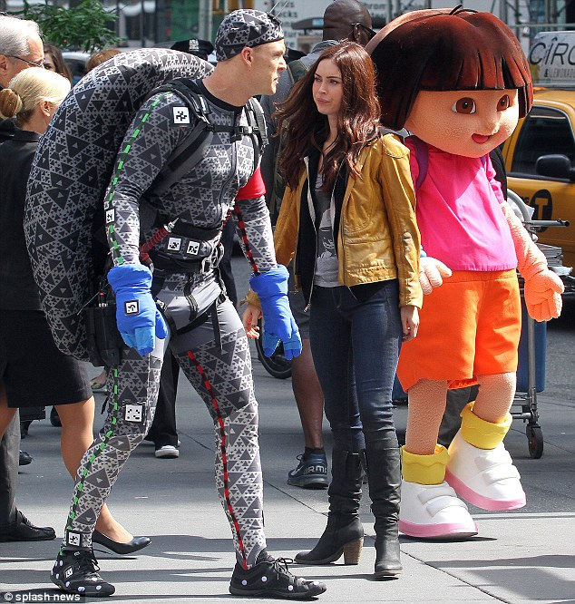 Character clash: While filming on the busy NYC streets, the Teenage Mutant Ninja Turtles met Dora the Explorer