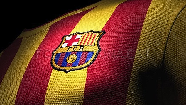 Flying the flag: Barcelona will wear the Catalan colours away from home next season