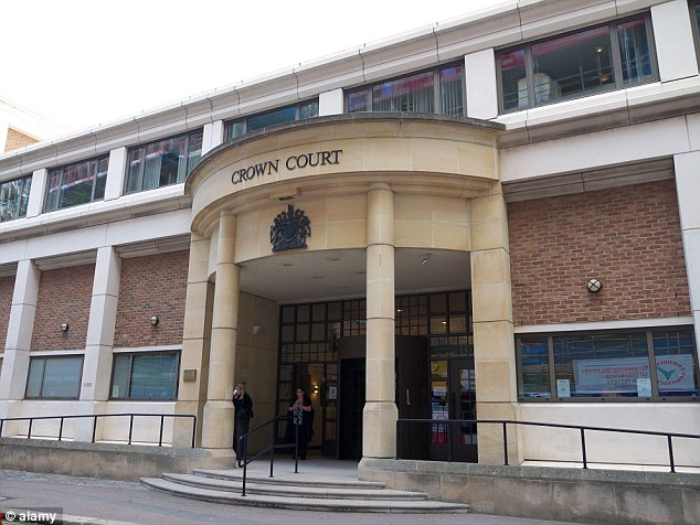 Alleged scam: It was not until six days later that the clinic realised the cards, belonging to two women and one man, were stolen when it was contacted by the bank, Blackfriars Crown Court (above) heard