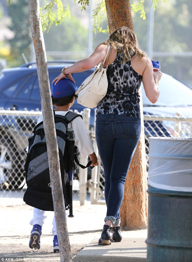 Show of affection: The country singer doted on the six-year-old boy just hours before a heated exchange with his birth mother