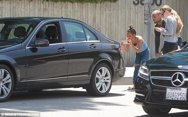 Hands-on: Karreuche was seen acting decidedly like a girlfriend, taking a picture of the car as evidence