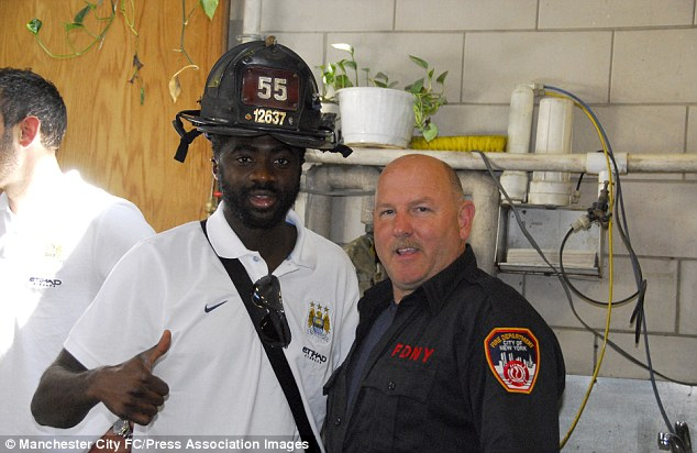 Thumbs up: Kolo Toure and some other City players visited the New York Fire Department