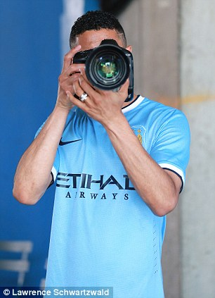 Role reversal: Clichy grabs the camera during the photoshoot