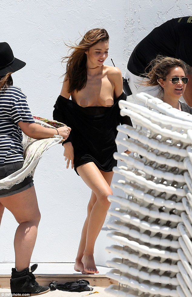 Oops! Miranda shows everything as her top falls down during the shoot