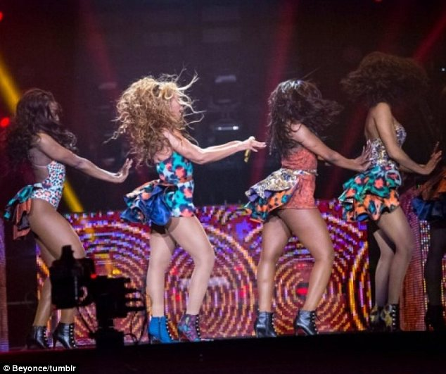 Wild thing: Beyonce and her backup dancers wore similar animal print outfits in bright colours during a recent show in France