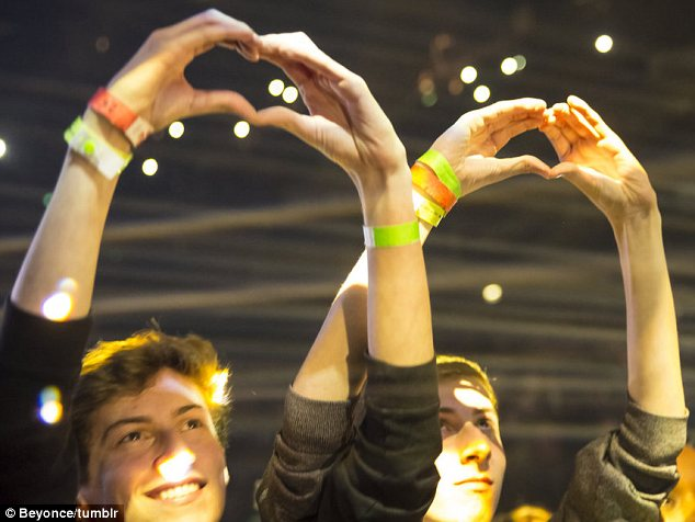 Showing their love: Fans made heart signs with their hands in the hope that their idol would see