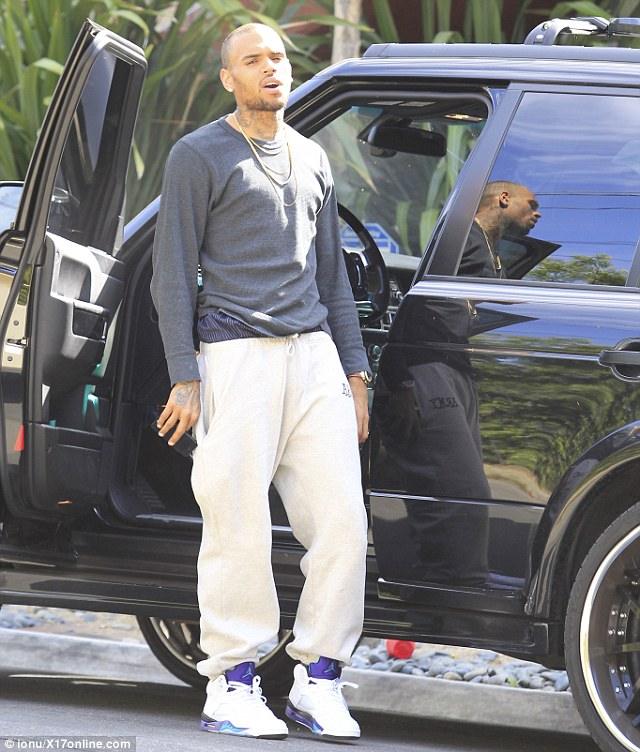 Not a happy camper: Chris looked annoyed as he stood next to his car, clearly itching to get out of there