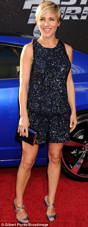 Very different looks: Elsa Pataky (L) wore a sequined black playsuit while Michelle Rodriguez chose a white gown to the Los Angeles premiere of Fast And Furious 6 on Tuesday