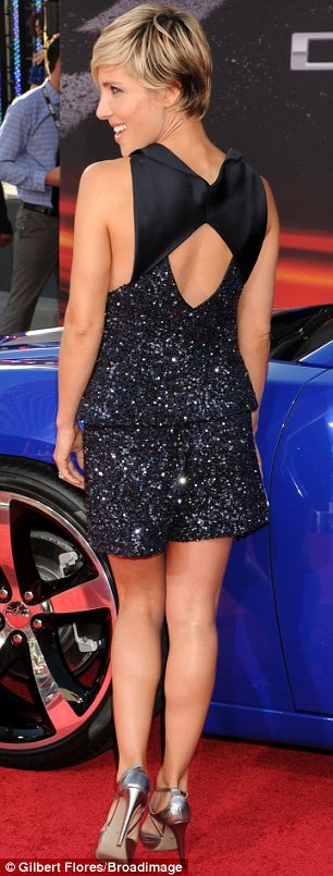 Shining star: Elsa glittered as she showed off her legs and some back in her daring but cute outfit