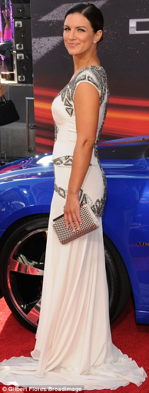 Grecian goddess: Gina Carano looked lovely in a flowing frock encrusted with small silver beads